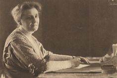 Quotes From Jane Addams, Settlement House Founder and Nobel Laureate: Jane Addams writing a letter at her desk