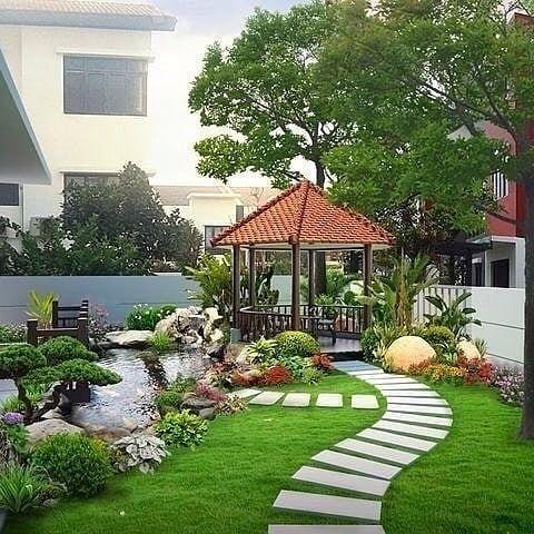 gambar mungkin berisi: rumah, pohon dan luar ruangan