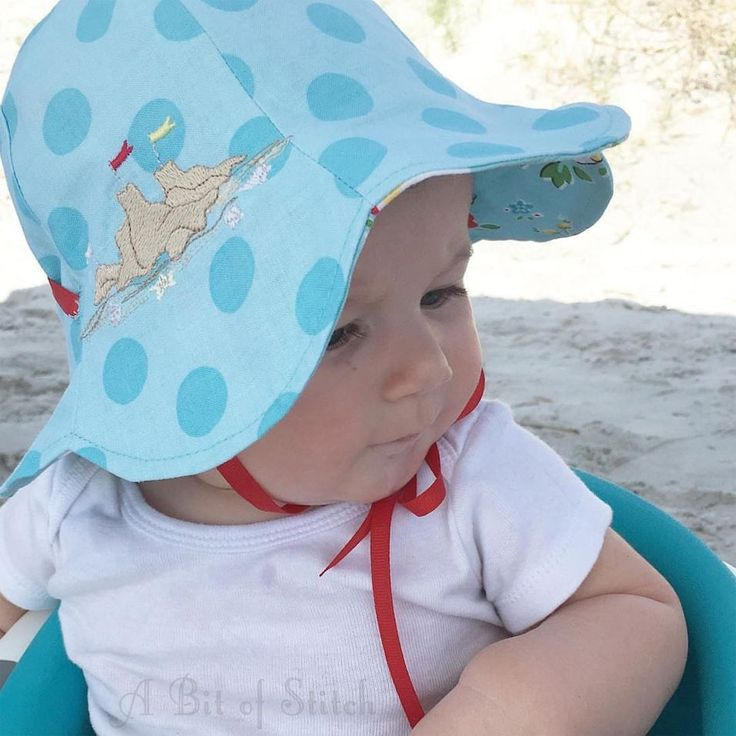 A reversible sun hat for baby! Free pattern from The Cottage Mama - Embroidery designs from A Bit of Stitch