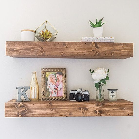 Handmade floating shelf stained to bring out the character in the wood. This piece gives a great rustic look and can be used for displaying home goods in living rooms, organizing bathrooms and dressing up kitchens. Check out our client reviews & Instagram @thecleansedpallet to get inspired! Our shelves are built hollow and come with a custom bracket specific to the dimensions of the shelf. The bracket screws into the wall and the shelf slides over completely concealing the bracket. To ensure…