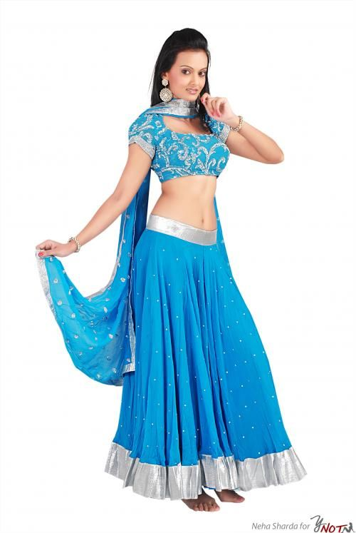Firozi Blue Chiffon Choli & Full-Gher Lehenga By : Neha Kamal Sharda Description   This garment features a beautiful firozi blue chiffon choli with delicate embroidery all over & full-gher lehenga with silver border along with chiffon dupatta.