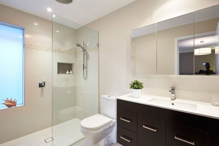 Bathroom Designs. Timeless bathroom with neutral colours and contrast cabinetry.
