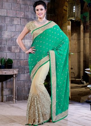 Off White And Sea Green Georgette Party Wear Saree http://www.angelnx.com/Sarees