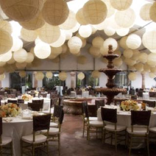 Various Sized Paper Lanterns Hang From The Ceiling Of The