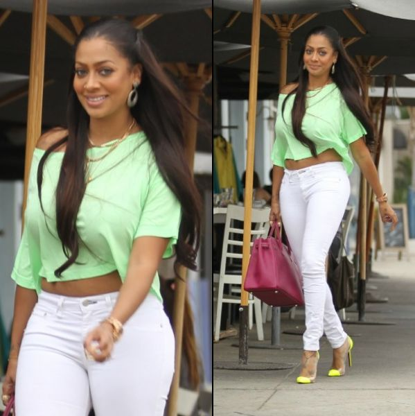 Lala Anthony in mint green crop top, white jean and lime CL's