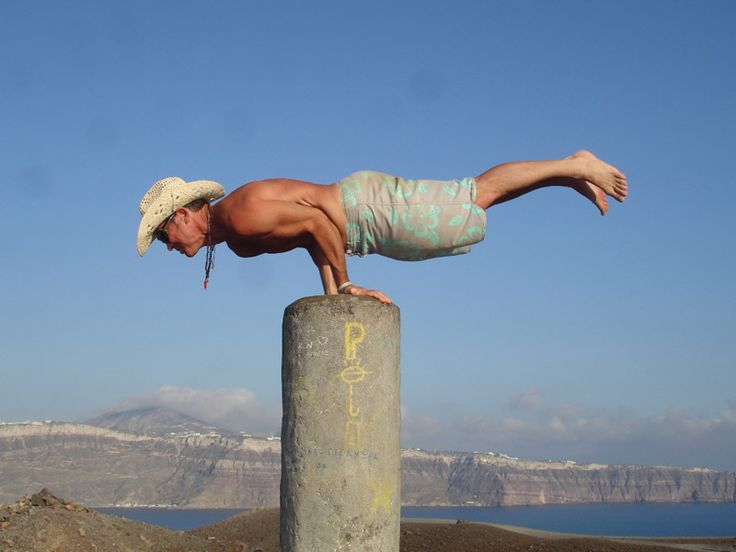 Balancing on a pole in the middle of nowhere on a volcano on Santorini island, Greece - selected by www.oiamansion.com
