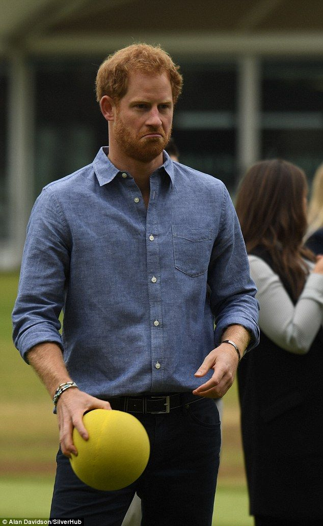 One is not amused! Harry looked less than impressed as he grimaced while practicing netbal...