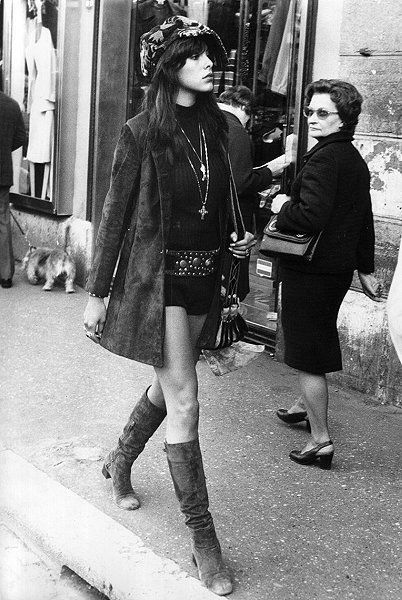 Hot pants and suede boots  Love that this image has the woman in  background