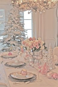 This formal diningroom is det up with lovely floral centerpieces and fine china tablescape in shades of pink and silver for christmas!!! Bebe'!!! It also has a second tree in the dining room!!!