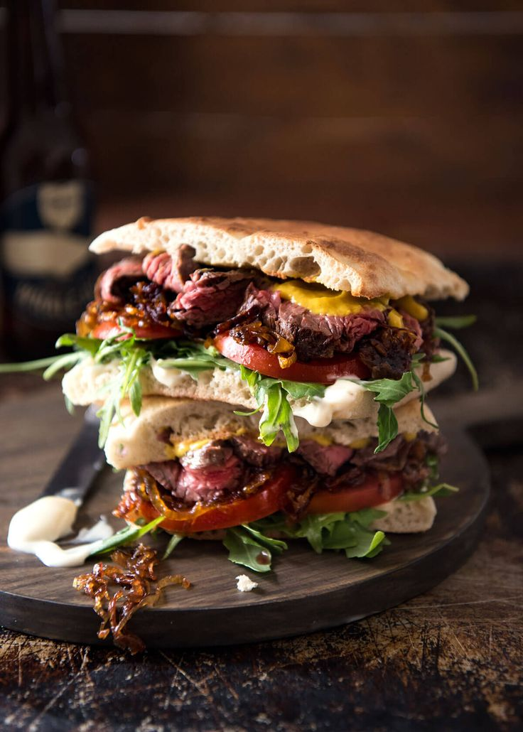 Sink your teeth into this juicy steak sandwich loaded with tender beef, caramelised onion, garlic aioli, mustard, rocket/arugula and tomato. Spectacular!