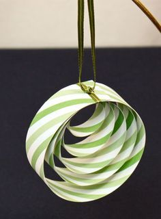 Simple and elegant, paper and ribbon quickly become this pretty paper circles ornament.