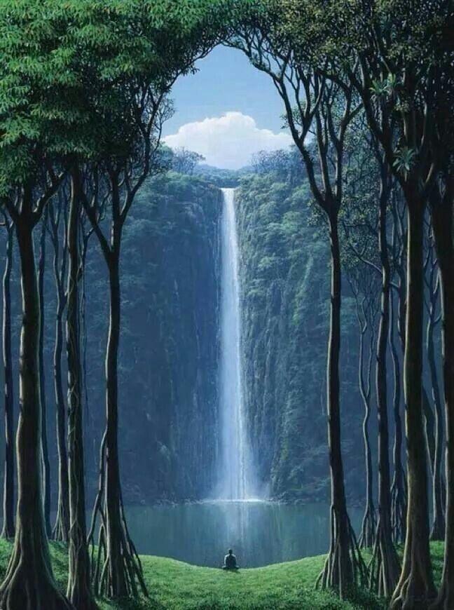 COLOMBIA: Es una paisaje en Colombia. Hay arboles altos y hierba verde. Hay una cascade largo en el centro.