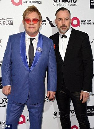 Elton John is pictured right with his husband David Furnish