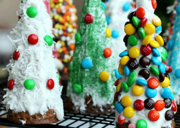 Decorate upside-down waffle cones to make Christmas tree desserts.