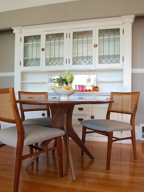 Example of a transitional dining room design in San Francisco with beige walls and medium tone hardwood floors