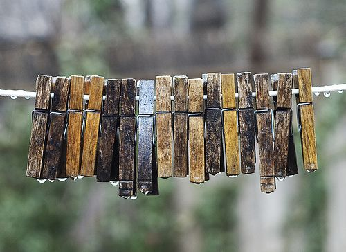 I remember clothes pins left on a line. My mother always gathered them along with the dried laundered clothes, but they hug on a neighbor's and line looked like those in this photo. I always wanted to gather and dry them for her but I was too small to reach the line.