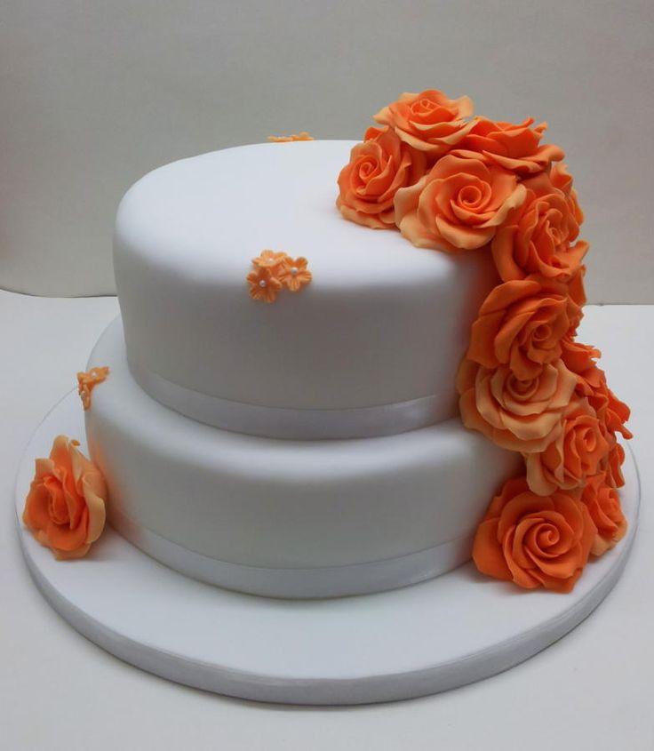 """Orange Rose cascade Wedding cake. An 8"""" fruit & 10""""  vanilla sponge with sugarpaste roses :o)"""