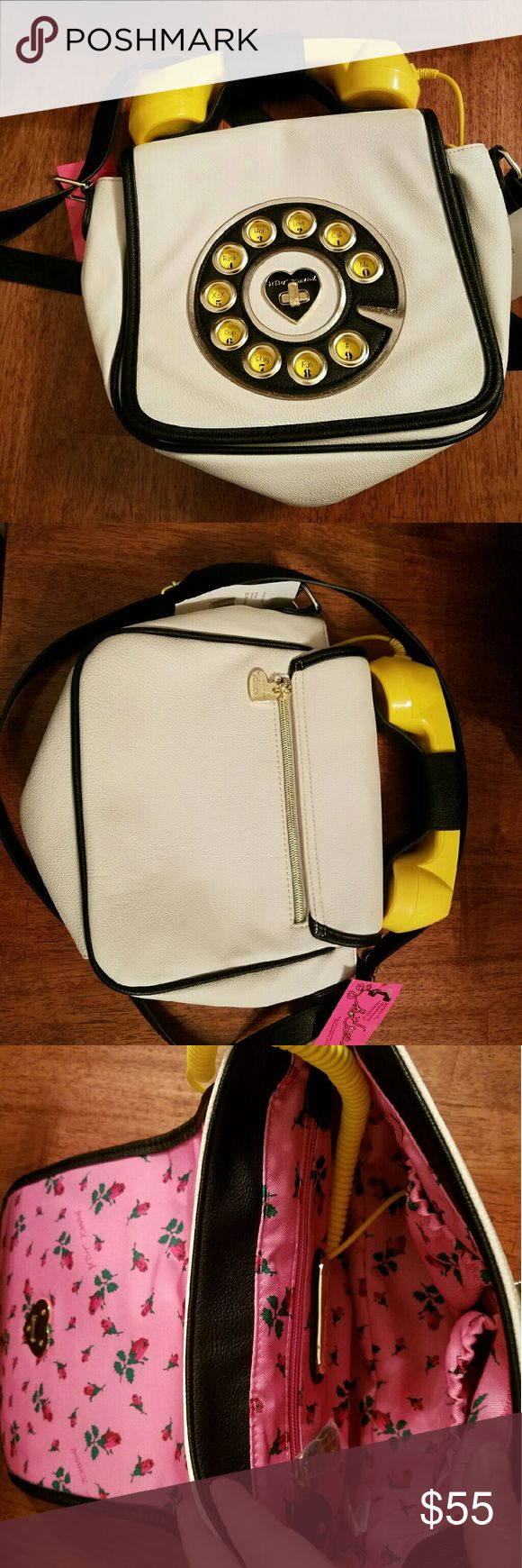 Betsey Johnson Phone Crossbody NWT Betsey Johnson Phone Crossbody NWT  Phone really works. Plugs in to ear bud jack on cellphone, answer and end calls on handset. Would be a great Christmas gift for teens.  Orig  $98 asking  $55 LAST ONE IN STOCK Betsey Johnson Bags Crossbody Bags