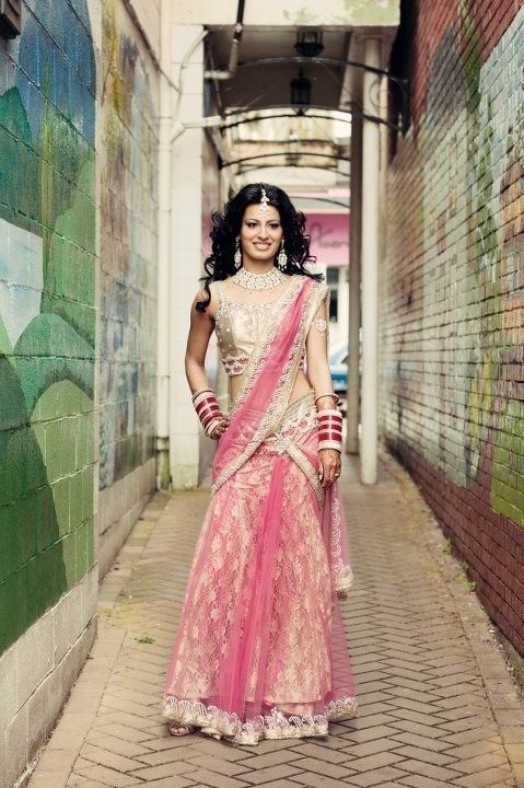 Beautiful Indian bride in Pink lehenga saree & red chuda. #Beautiful #Indian #Bride #lehenga #chuda