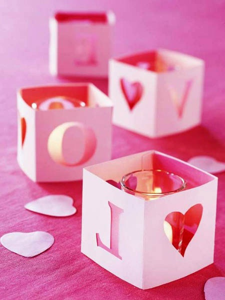 Valentine's day wedding?  Or maybe you are simply using pinks and reds as your wedding colors?  Check out these DIY wedding centerpiece additions with paper cutouts and candles!