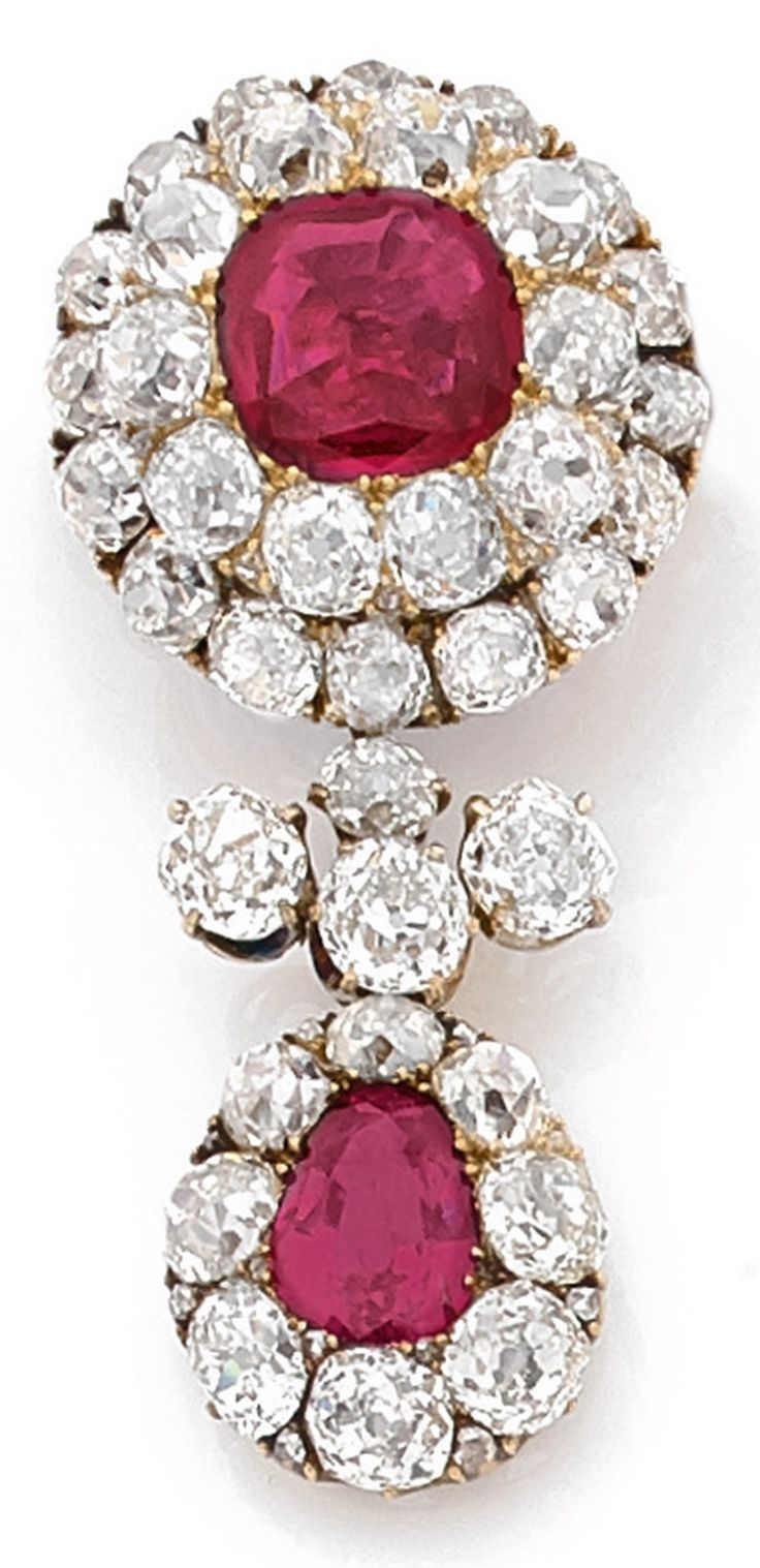 A 19th century antique Burmese ruby, diamond and 14K gold brooch/pendant, English. Set with a cushion-cut ruby, approx. 3 carats, framed by a double circle of old-cut diamonds, suspending a ruby pendant, approx. 2 carats, surrounded by diamonds. The pendant detachable. 4.4cm. #antique #brooch #pendant