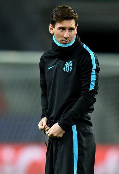 Lionel Messi looks on during a FC Barcelona training session on the eve of the UEFA Champions League groupe E match against Bayer Leverkusen at BayArena on December 8, 2015 in Leverkusen, Germany.