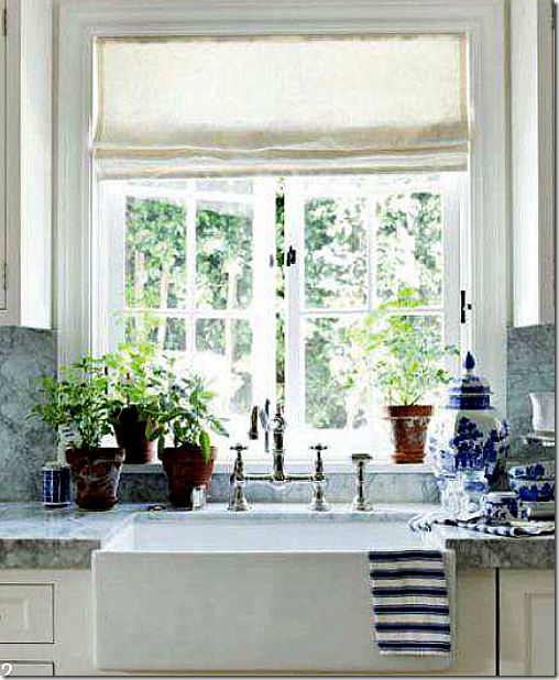 Love blue and white porcelain accents in white kitchen of Designers Mark Sikes and Michael Griffin for House Beautiful Dec/Jan 11
