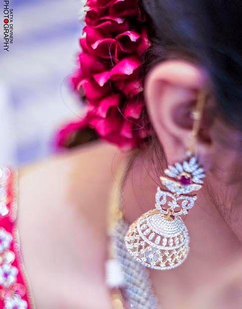 Jewellery Designs: Bride in Spectacular Diamond Jhumka