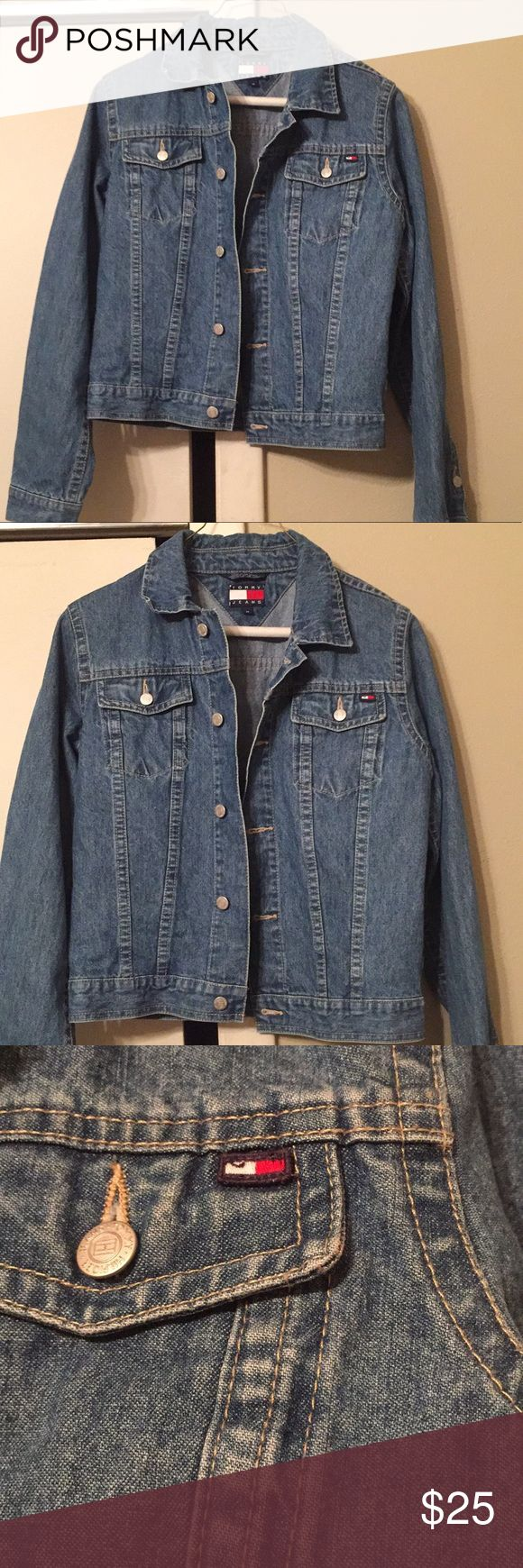 Vtg Tommy Hilfiger Jean jacket retro denim coat price firm no flaws vintage Tommy Hilfiger jean jacket . Excellent retro condition 90s Tommy Hilfiger jacket. Tommy flag logo on front and back. Button closure with Hilfiger logo. Perfect retro denim jacket for the season. size medium slightly stretchy possibly a juniors medium not sure. price firm ships next day  tags: 90s Levi's jean jacket retro oversized distressed jean jacket wrangler gap Tommy Hilfiger Jackets & Coats Jean Jackets