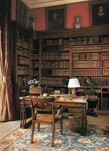 What I love most about these kinds of libraries is the wood tones, both of the woods and of the books.