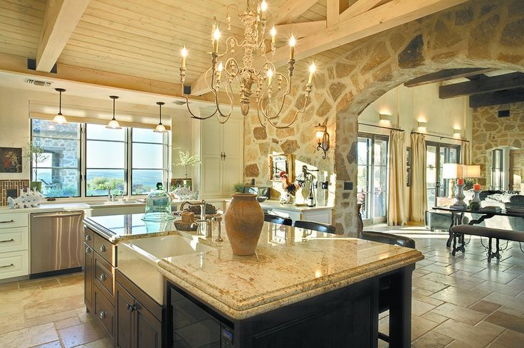 (belvedere austin home off hamilton pool road.) love the massive stone archway opening to family room, the thick stone island counter, the natural stone floor and the traffic flow in this kitchen. also like the repeating stone work in family room.