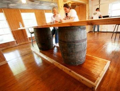 Use wine or whiskey barrels to create a patio bar.