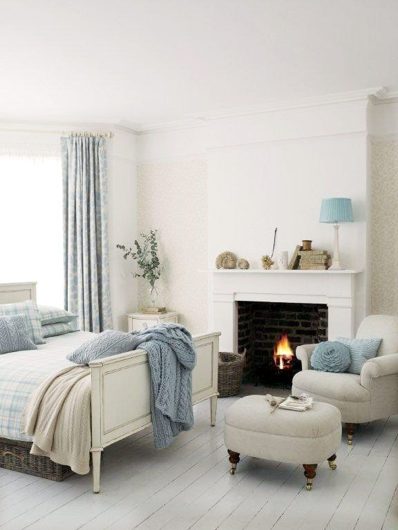 another instance of an all white room in which blue is used only on accessories - Blue And White Bedroom Designs