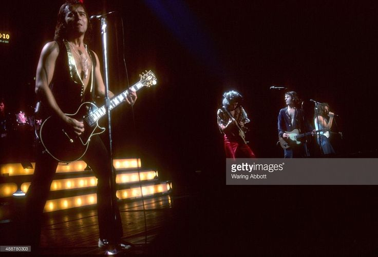 British guitarist Mick Jones, American bassist Ed Gagliardi, British rhythm guitarist and multi-instrumentalist Ian McDonald and American vocalist Lou Gramm of the British-American rock group Foreigner performing live at New Haven Veteran's Coliseum on January 1, 1978 in New Haven, Connecticut.
