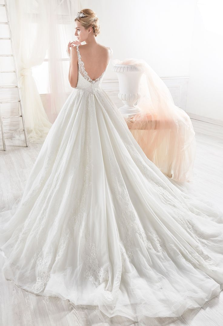 Marvellous white princely dress in tulle with beaded rebrode lace, beautified with jewel beading applications.