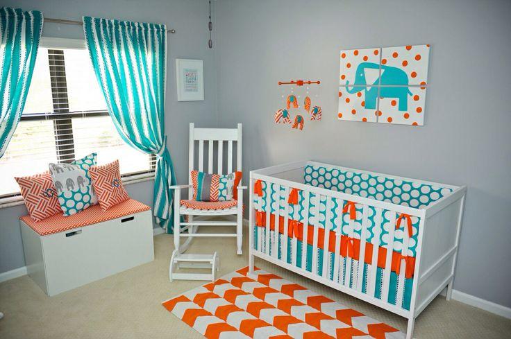 Side shot of the nursery - a modern teal, gray & orange elephant nursery