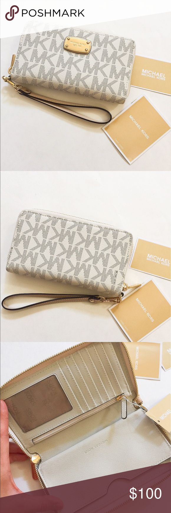 NWT Michael Kors jet set leather wallet/wristlets Brand new with tag. Never used. Can fit in iPhone 6 Plus without a phone case. ❌no trade ❌no lowballing offers!!! Michael Kors Bags