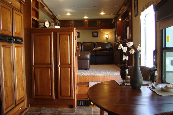5th wheel with a front living room at hershey rv show 73890