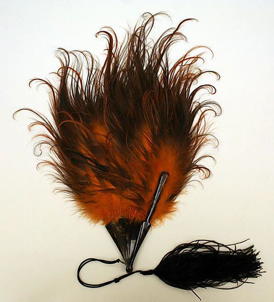 Fan  Date: early 20th century Culture: American or European Medium: feathers, cellulose Dimensions: Height: 22 1/2 in. (57.2 cm) http://www.metmuseum.org/collections/search-the-collections/80062730