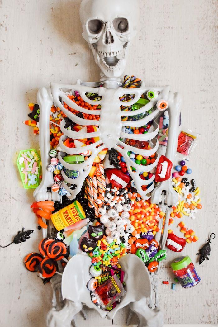Halloween Skeleton Candy Charcuterie Board Kara S Party Ideas Halloween Skeletons Halloween Goodies Halloween Hacks