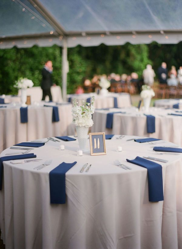 simple navy and white wedding table decor || Photography: Virgil Bunao Fine Art Weddings, via Style Me Pretty