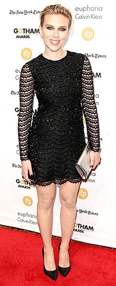 Scarlett Johansson walked the red carpet in an LBD with scalloped beading and long lace sleeves. A golden clutch and sparkling shoes finished the outfit.