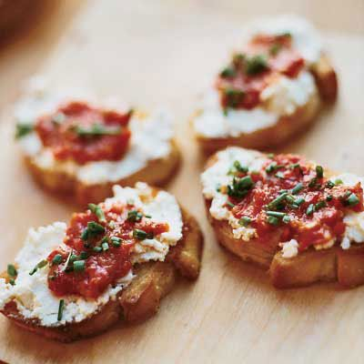 Goat Cheese Crostini with Pickled Peppers from delish.com