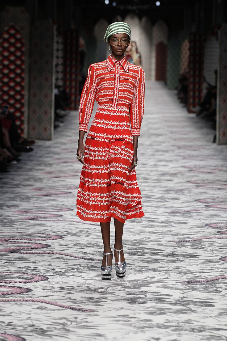 On the runway at Gucci Spring Summer 2016, a printed silk skirt and blouse featuring a Gucci script that Alessandro Michele found in a late 70s printed shirt from the House archive.