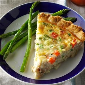 Crab Quiche Recipe -Chopped green onions and sweet red pepper bring a bit of color to this golden entree. The creamy filling features imitation crabmeat and Swiss cheese, making it a morning mainstay that brunch guests will clear their plates for.