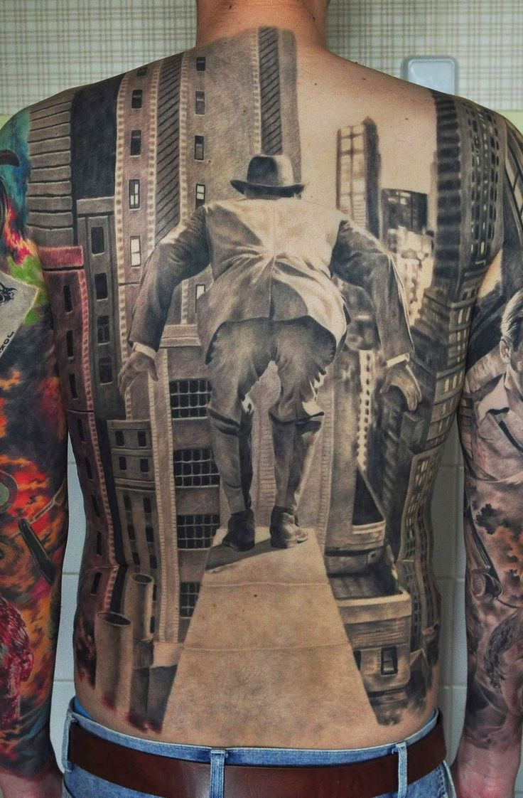 This tattoo of a man walking out onto a ledge looking to jump from a building was once again created by Russia's Den Yakovlev. It looks as though it is a recreation of the great Stock Market Crash of 1929, judging by the man's attire and method of potentially ending his life. Skyscrapers line the background of the piece as the ledge and the man on it appears in the foreground of this 3D tattoo. The black and gray only tattoo has a distinct noir vibe as well. Amazing.
