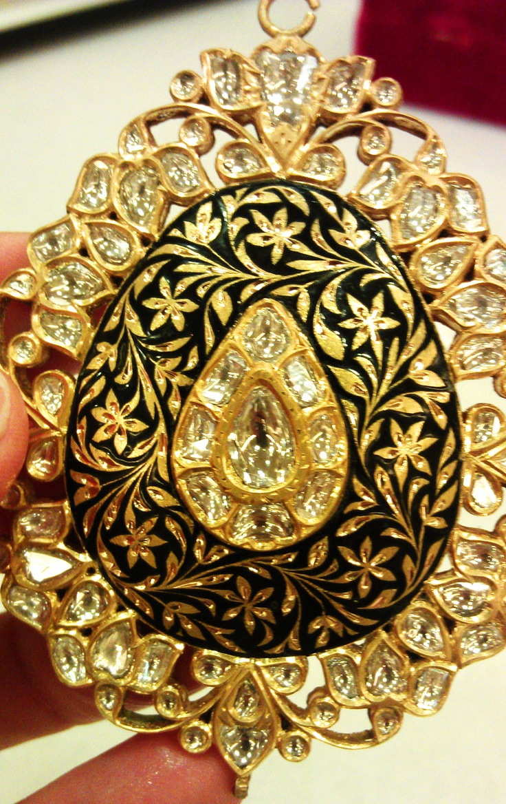 One of Sunita Shekhawats pendants in 22ct gold with diamonds and enamel decoration on both sides.