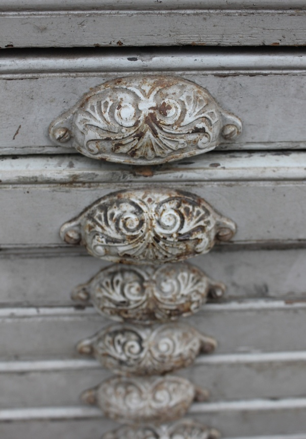 antique cabinets  pulls- i like the idea of painting old icky ones & distressing to look like these