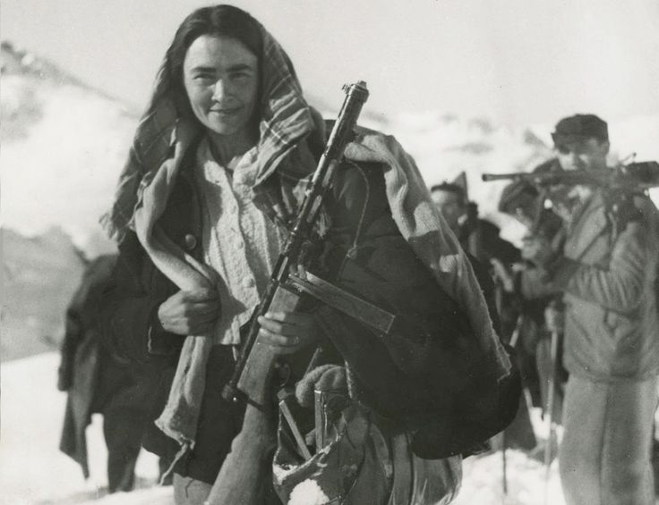 Prosperina Vallet, an Italian partisan, in the mountains between Italy and France (ca. 1944). She is carrying a Beretta Modello 38-44 submachine gun.