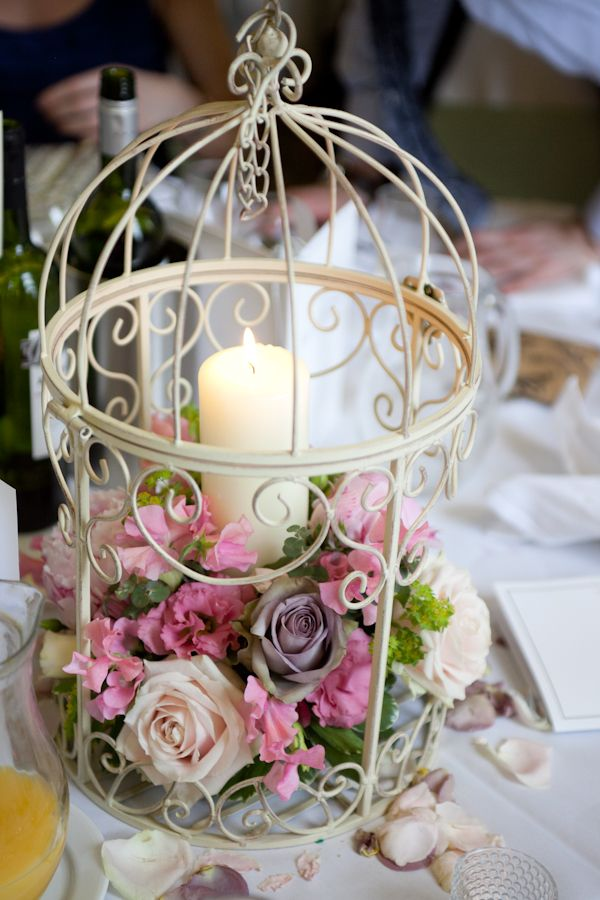 Birdcage Centerpiece, love the rustic elegance and not just flowers. You could do almost anything